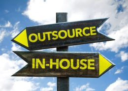 bigstock Outsource In House signpost 113621258