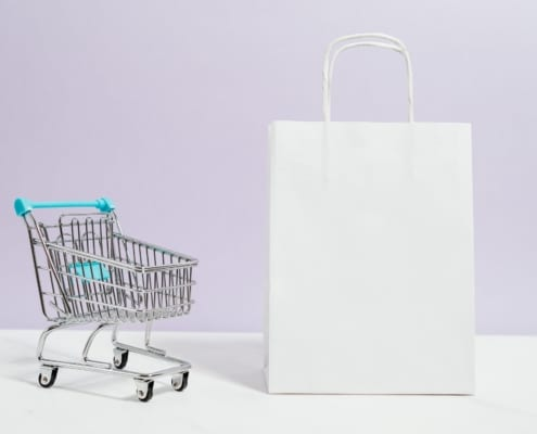 Mini trolley with white paper bag